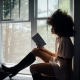 Introverted woman reading a book