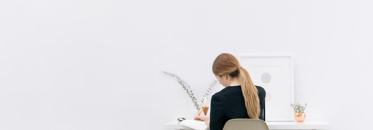 woman journaling and self-reflecting