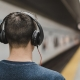 man listening to podcasts about mental health